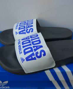 Dép adidas train the world chữ xanh